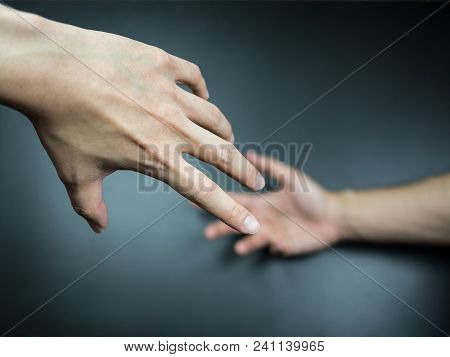 Hands Reaching To Each Other On Background