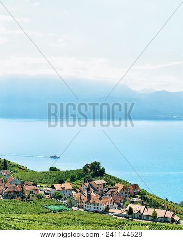 Lavaux, Switzerland - August 30, 2016: Lavaux Vineyard Terraces Hiking Trail And Ship On Lake Geneva