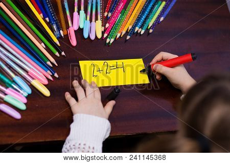 Cute Little Kid Girl Decide Mathematics Exercise. Concept Of Kids Education, Happy Lifestyle