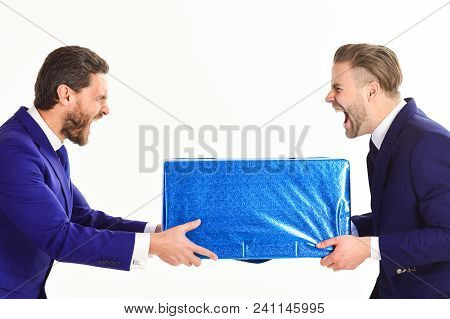 Businessmen With Mad Faces Take Away From Each Other Blue Package, Isolated On White Background. Two
