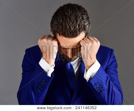 Stressed And Tired Concept. Young And Handsome Businessman Unhappy Stressed With Headache Hold Fists