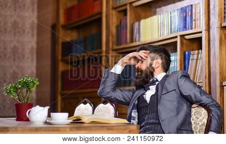 Man Has Terrible Headache. Bearded Man In Formal Suit Suffers From Negative Thoughts And Looks Unsat