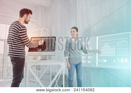 New Diagram. Clever Experienced Web Designer Showing A Diagram On The Wall While Her Professional Co