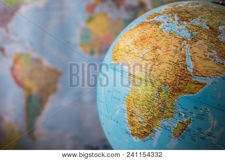 Africa And Middle East Map On A Globe With Earth Map In The Background.