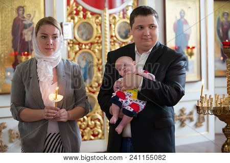 Belarus, Gomel, May 6, 2018. Church Of Volotovo. Godparents In The Church At The Baptism Of A Newbor