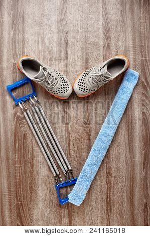 Heart Shaped Composition Of Gym Shoes, Expander And Towel