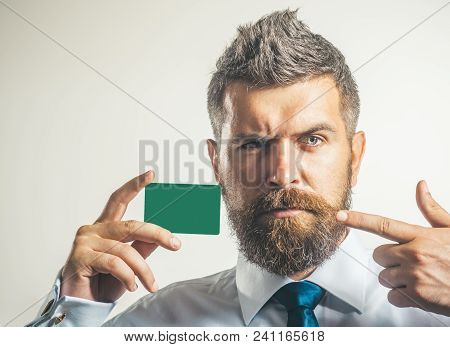Businessman In A White Shirt And Blue Necktie Show Credit Card Or Visiting Card, Closeup. Bank Card,