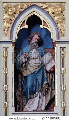 STITAR, CROATIA - JUNE 24: St. Mark the Evangelist statue on the pulpit in the church of Saint Matthew in Stitar, Croatia on June 24, 2017.