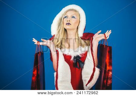 Holidays, Celebration, Shopping, Sale, Commerce, Happiness, Leisure Concept - Attractive Woman In Sa
