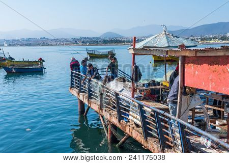 Coquimbo, Chile--april 7, 2018. Fishermen Cast Their Lines From A Pier In The Port City Of Coquimbo,