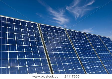 Mono-crystalline solar panels against a blue sky