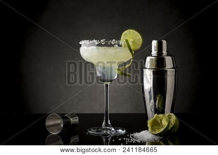Classic Lime Margarita Cocktail With Tequila, Triple Sec, Lime Juice, Crushed Ice And Some Salt On T