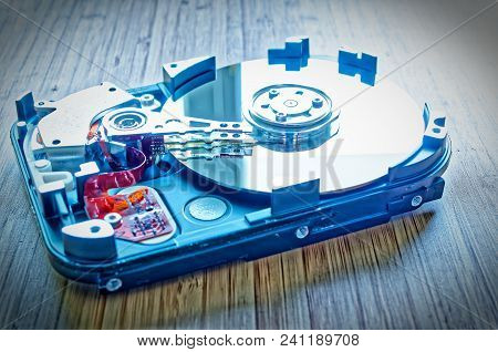 Hard Drive 3.5 Inches As A Data Storage With Motherboard On A Bamboo Table