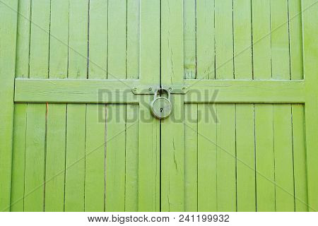 Fragment Of Old House Painted Locked Bright Green Outdoor Of Wooden Planks As Background.