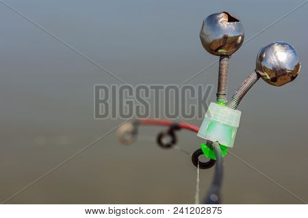 Pair Of Fishing Bells. Bells Will Ring When The Fish Is Hooked. Isolated On Grey