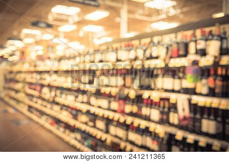Vintage Blurred Wine Shelves With Price Tags On Display In Supermarket