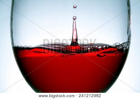 Red Wine In Glass, Splashing, Splash, Bubbles, Drops Of Wine Close Up Macro Texture Background