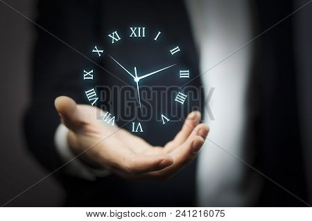 Businessman Hand Holding Clock In The Screen
