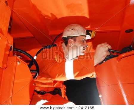 Miner Operating Heavy Machinery