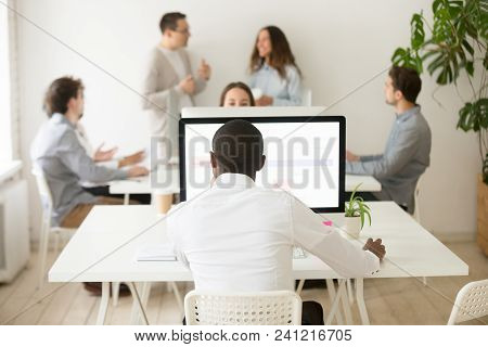 Rear View At African American Employee Working On Computer In Multiracial Office, Black Employee Foc