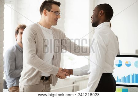 Caucasian Team Leader Or Company Boss Promoting Successful African Manager Handshaking Expressing Gr