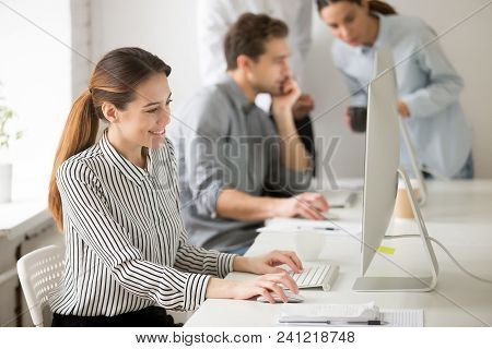 Beautiful Smiling Young Businesswoman Working On Desktop Computer In Office Typing Message To Client