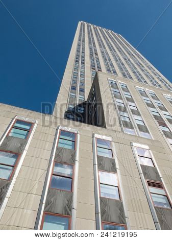 NEW YORK, NY USA - JAN 14 2013: Upward view of the Empire State Building and it's art deco facade designed by Shreve, Lamb & Harmon and opened April 11th 1931