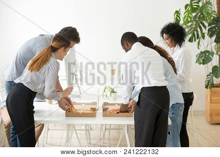 Rear View At Corporate Employees Team Sharing Pizza In Office, Multiracial Colleagues Eating Italian