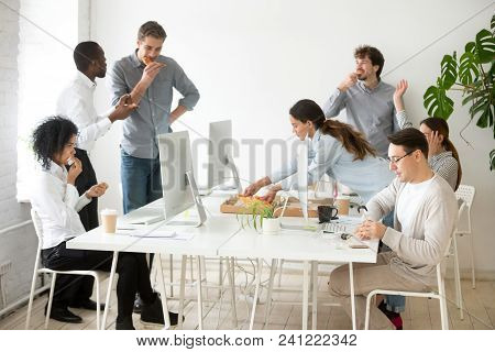 Friendly Multi-ethnic Team Having Lunch Together Eating Pizza In Office, Multiracial Employees Talki