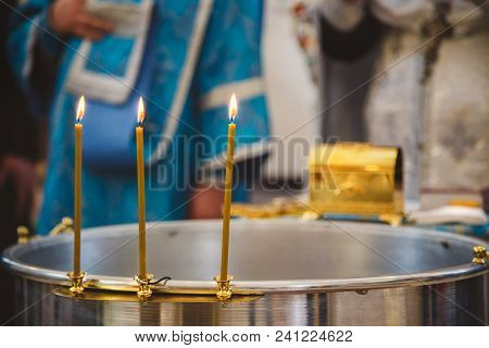 Christening In The Church, Candles At Children Baptismal Font. Details In The Orthodox Christian Chu