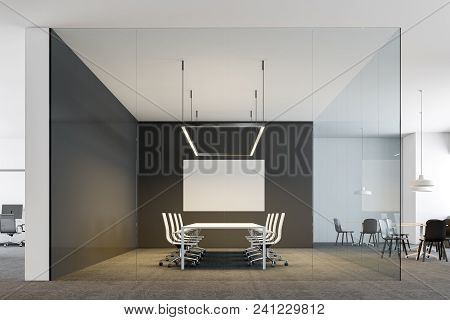 Black And White Office Interior With A Conference Room With A Poster On The Wall And A Lounge Area W