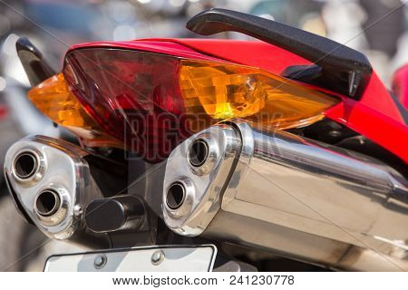 Powerful Motorcycle Exhaust Pipes Rear Closeup Photo