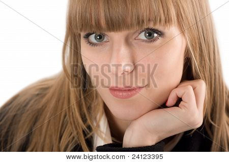 Portrait Of Smiling Young Woman Resting Her Chin On Hand
