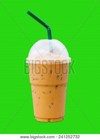 Ice Coffee  In Glass On Green Background