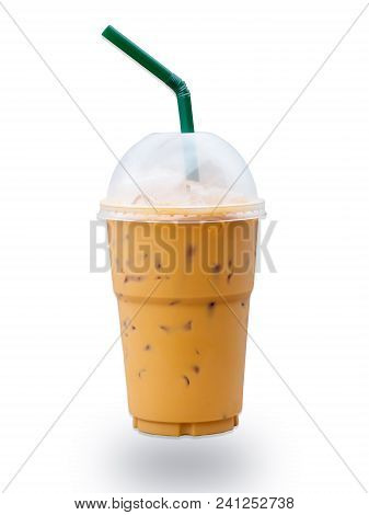 Iced Coffee With Green Straw In Plastic Cup Isolated On White Background