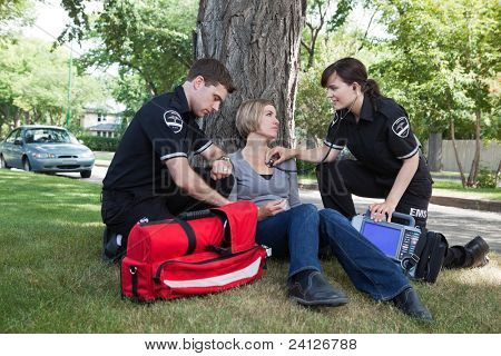 Emergency medical professionals assessing an injured patient on the street