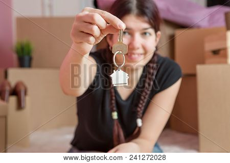 Image Of Young Brunette With Keys From Apartment Against Blank Wall In Apartment