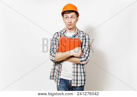 Young Curious Handsome Man In Protective Orange Hardhat Holding Case With Instruments Or Toolbox Iso