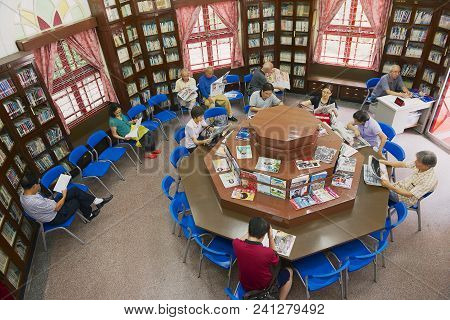 Macau, China - September 13, 2013: Unidentified People Read Newspapers And Magazines In The Chinese