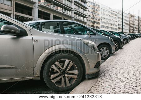 Street Parking With Cars In Lisbon, Portugal. Cars Parked On Street. Penalties For Parking And Payme