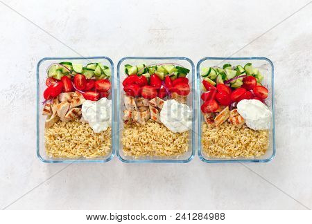 Greek Style Grilled Chicken Breasts With Tzatziki And Freshly Diced Vegetables Prepared And Ready To