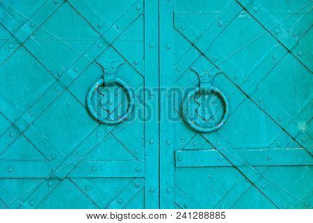 Metal Green Aged Textured Door With Rings Door Handles And Metal Details. Metal Architecture Backgro