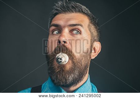I Have An Idea! Crazy Guy With Light Bulb In His Mouth. Bearded Man With Eco Bulb Light Holds In Mou