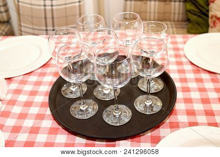 Sparkling Glassware Standing On Tray On Dinner Table With Checkered Tablecloth In Restaurant, Copy S