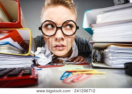 Facial Expressions During Work. Crazy Thoughtful Accountant Businesswoman Surrounded By Documents An