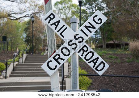 Railroad Crossing Warning Sign Along Train Tracks
