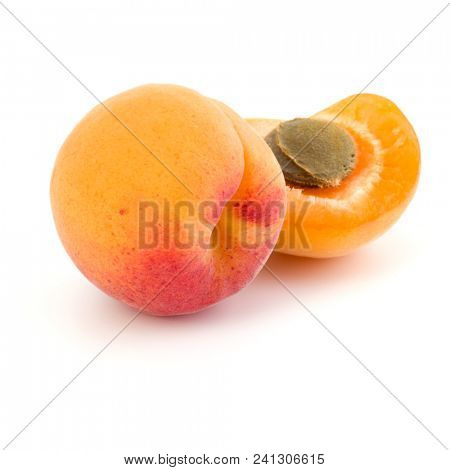 Two apricot fruit isolated on white background cutout