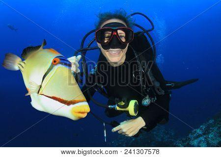 Scuba diving in ocean with fish