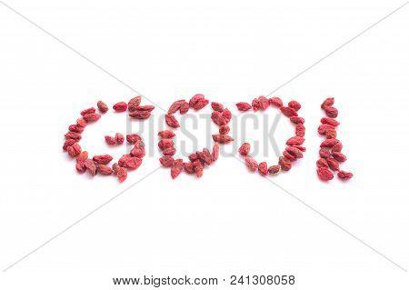 Goji Berries Shaped Into Word 'goji' Isolated On White