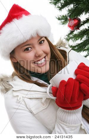 A pretty woman drinking coffee during Christmas over white